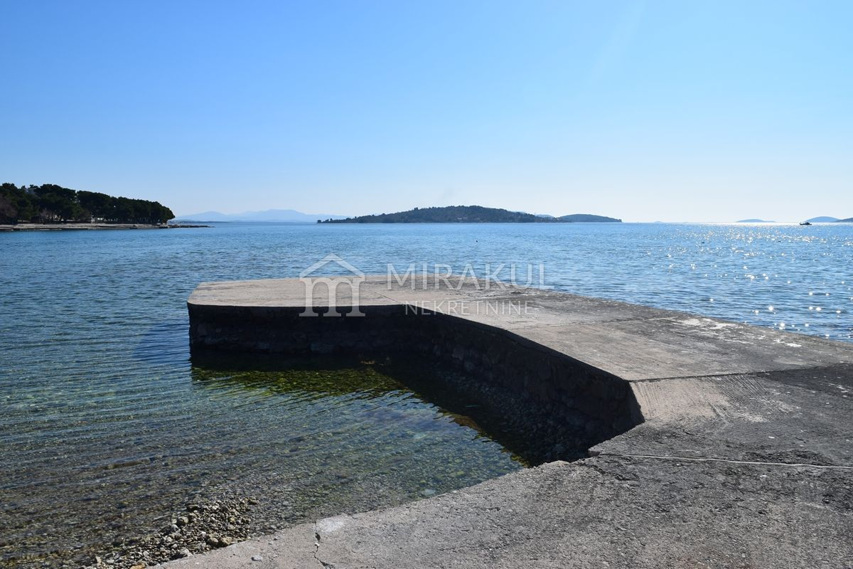 Properties Vodice Croatia, land, Mirakul Real Estate agency, ID - GV - 300, Large plot first row to the beach