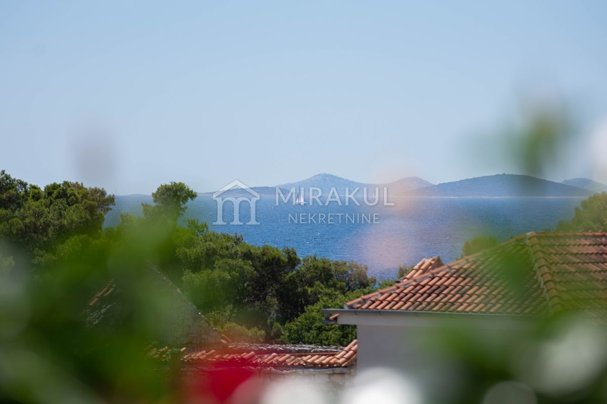 Real estate Tribunj, Sovlje, Flat S0 near the sea and beach, building A1
