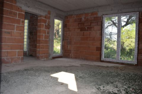 Croatia - Betina, House under construction in the second row to the beach