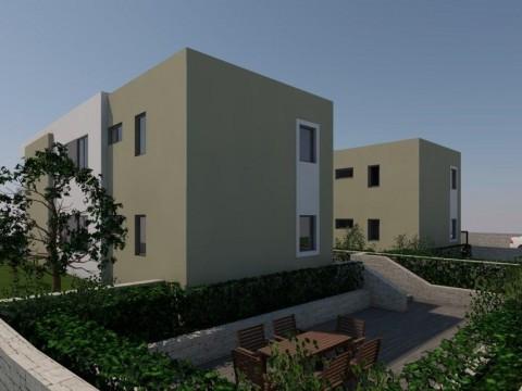 Njivice, apartma za prodajo v prvem nadstropju nove stavbe z vrtom in pogledom na morje!