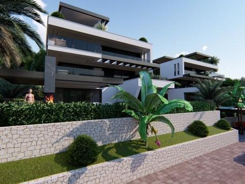 Njivice, prodaje se ekskluzivan apartman od 62m2 u prizemlju modernog stambenog objekta samo 50m od mora! U izgradnji!