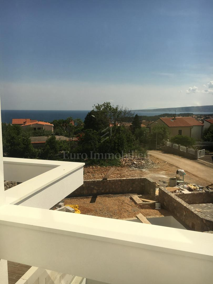 Exclusive new apartment with open sea view