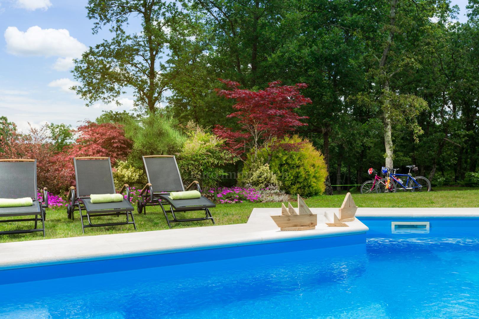 Traditional villa with a spacious garden in a natural environment