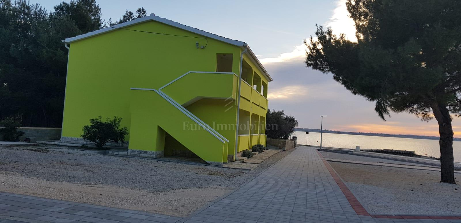 Apartment house with six apartments first row to the sea
