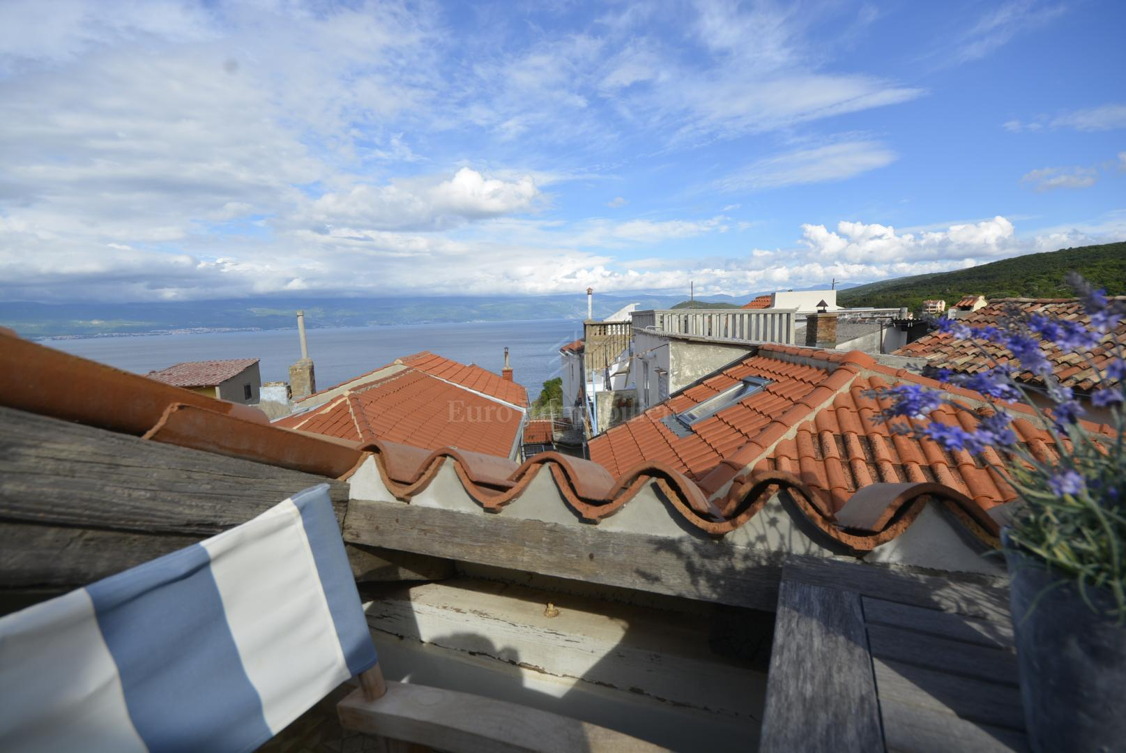 The indigenous mediterranean house in a row with a sea view
