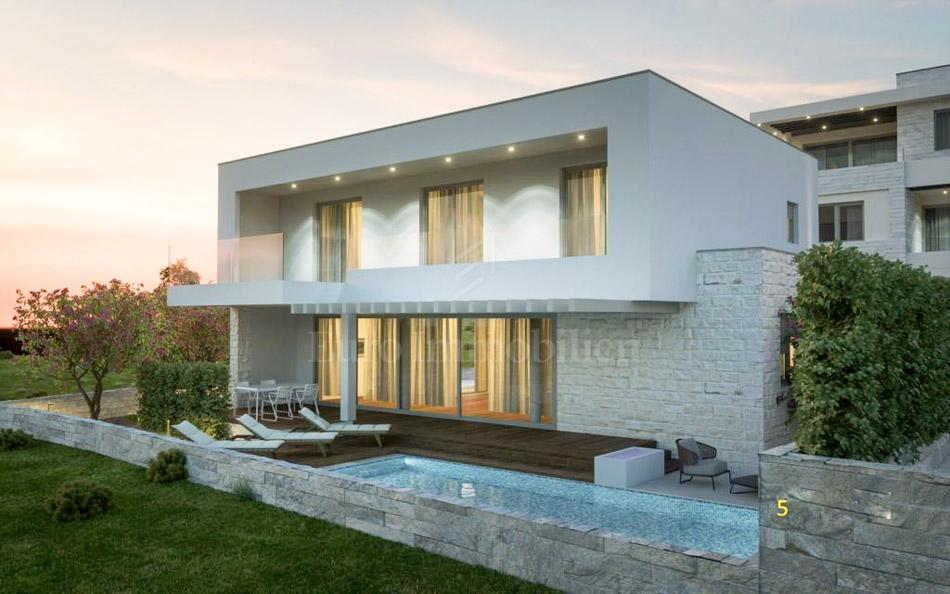 Modern house with swimming pool under construction!