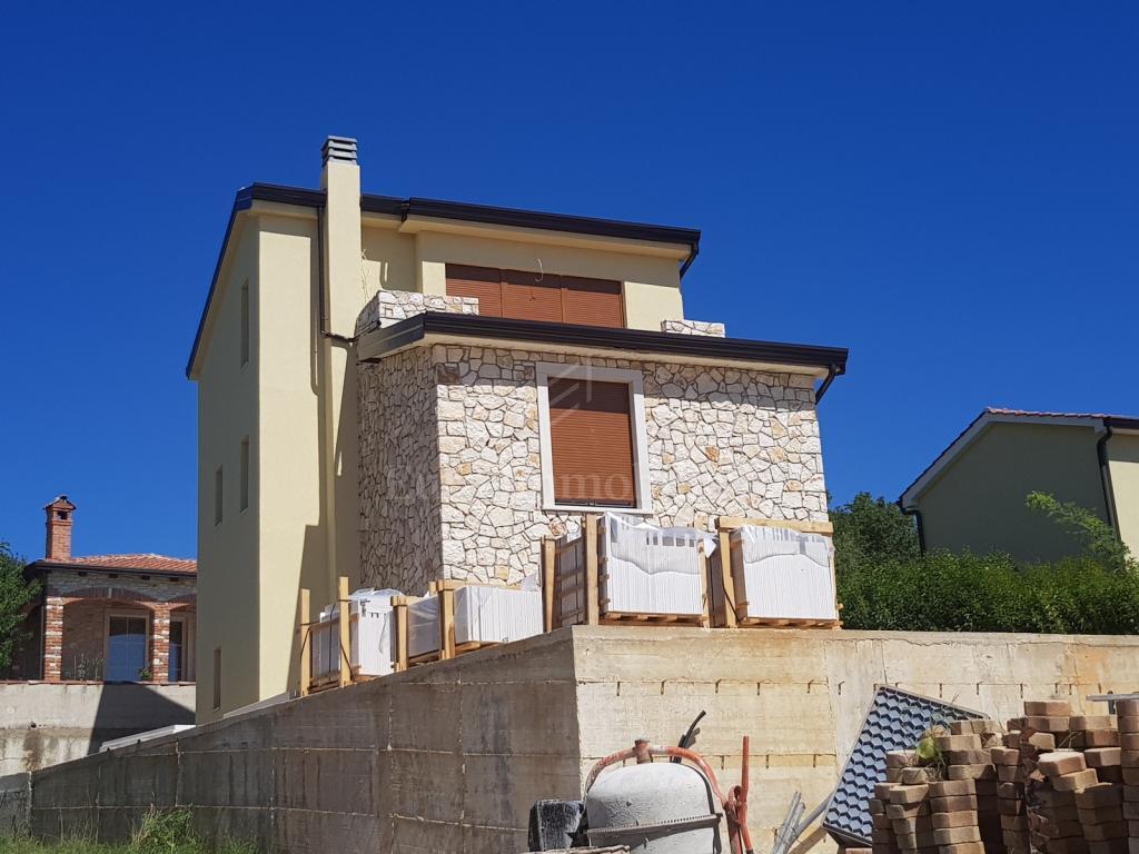 Nova kuća s bazenom i pogledom na more